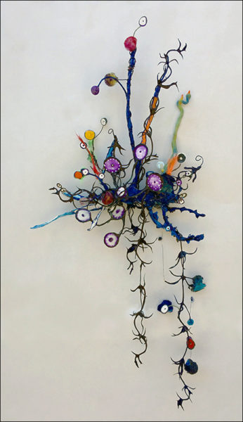 "Maura Bendett Title: Purple Mirror Dots Medium: Steel, acrylic, paper, pom-poms, mirror, fishing line, sculpy, resin Date of work: 2016 Size: 24"" H x 11"" W x 3"" D Signed verso and framed Retail value: $1800 Winning Bid: $575.00"